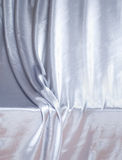 Silver silk drapery Royalty Free Stock Images