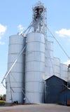 Silver Silo. Vertical image of two grain siloss Stock Photos