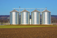 Silver silo in rural landscape Stock Images