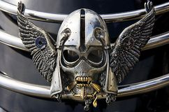 Silver Skull On Motorbike. Closeup of a silver and gold decorative skull on a motorbike mud guard Stock Image