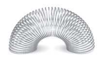 Silver slinky spring isolated Royalty Free Stock Images