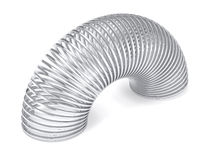 Silver slinky spring isolated royalty free stock image