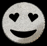 Silver smiling face shining on black Stock Image