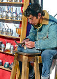 Silver Smith making cups for mate tea. Argentina Royalty Free Stock Photos