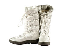Silver snow boots. Silver snowboots isolated on a white background Stock Photography