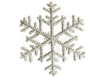 Silver snowflake. Christmas decoration silver snowflake, isolated over white Stock Image