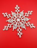 Silver snowflake. On red background Royalty Free Stock Photos