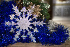 Silver snowflake on blue Royalty Free Stock Photos