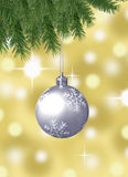 Silver snowflake christmas balls with abstract bokeh background and pine branches Stock Photos