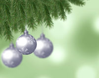Silver snowflake christmas balls with abstract bokeh background and pine branches Stock Photo