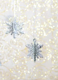 Silver snowflake christmas decoration. Christmas decoration - silver snowflakes on gold background Stock Image