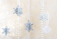Silver snowflake christmas decoration. Christmas decoration - silver snowflakes on gold Stock Photos