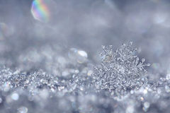 Silver snowflake. Macro close up from a snowflake in natural surroundings stock photo