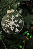 Silver Snowflake Ornament on a Christmas Tree stock images