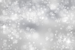 Silver snowflake with sparkle background Stock Photos