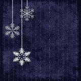 Silver snowflakes. Silvery snowflakes on dark blue pinstriped background Stock Photography