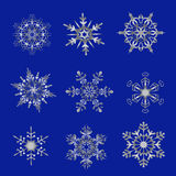 Silver snowflakes on a blue background Royalty Free Stock Photos