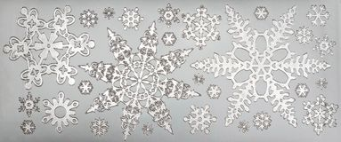 Silver snowflakes close up metal foliage. Shiny silver beautiful snowflakes set,  on gray background, decoration banner, border Royalty Free Stock Photo