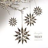 Silver snowflakes hanging against pale grey Stock Photography