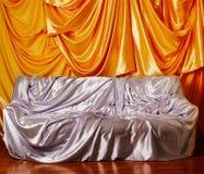 Silver sofa Stock Image