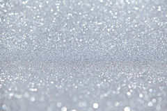 Silver Sparkles Light Background Stock Images