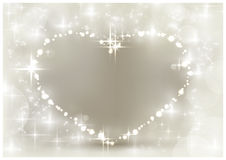 Silver sparkling Christmas heart. Heart shaped space for your text, surrounded by sparkling lights, stars and blurry light dots in shades of white and silver Royalty Free Stock Photography