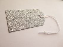 Silver sparkling Tag for gift on white background Royalty Free Stock Photography