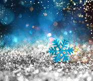 Silver sparkly crystal with snowflake background Royalty Free Stock Photos