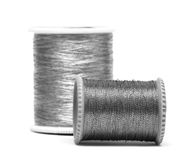 Silver spools of threads Royalty Free Stock Photography