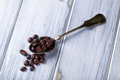 Silver spoon with coffee beans Stock Photography