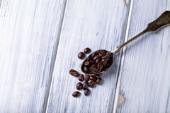 Silver spoon with coffee beans Stock Image