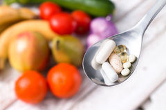Silver spoon with dietary supplements. Stock Images