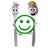 Silver spoon fork with smiley satisfaction sign Stock Photos
