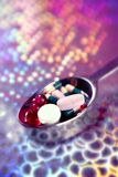 Silver spoon full of medicine pills Royalty Free Stock Photo