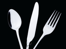 A silver spoon knife fork Stock Photos
