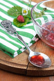 Silver spoon with strawberry jam Stock Image