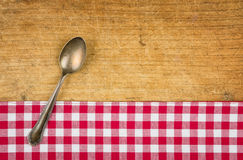 Silver spoon on a wooden board Royalty Free Stock Image