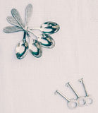 Silver spoons and antique keys Royalty Free Stock Photo