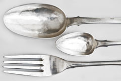 Silver spoons  and dinner fork Stock Photos