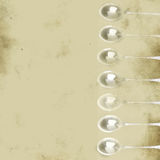 Silver spoons grunge background Stock Image