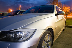 Silver sports car. New silver sports car in the evening Stock Photography