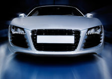 Silver sports car. Driving fast towards the camera Royalty Free Stock Photos