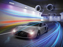 Silver sports car with colorful light trails in tunnel Royalty Free Stock Image