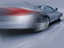 Silver Sports Car in motion Royalty Free Stock Image