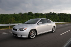 Silver Sports Car speeding on highway. A silver Scion tC speeding on the highway Royalty Free Stock Photography