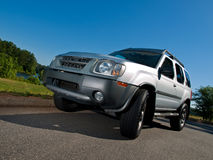 Silver Sports Utility Vehicle low pavement angle Royalty Free Stock Photography