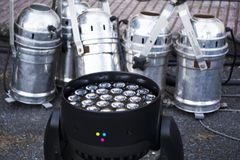 Silver spot light and moving head rgb led system on stage preparation stock photography