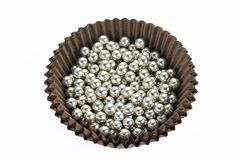 Silver sprinkle balls cake decoration isolated stock images