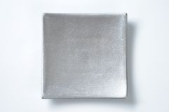 Silver square plate Stock Image