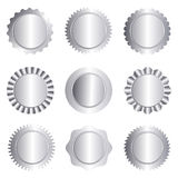 Silver stamp seal collection isolated on white. Set of different silver approval seal , stamp, badge, and rosette shapes isolated on white Stock Photography